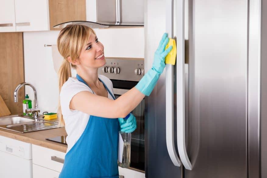 woman cleaning fridge