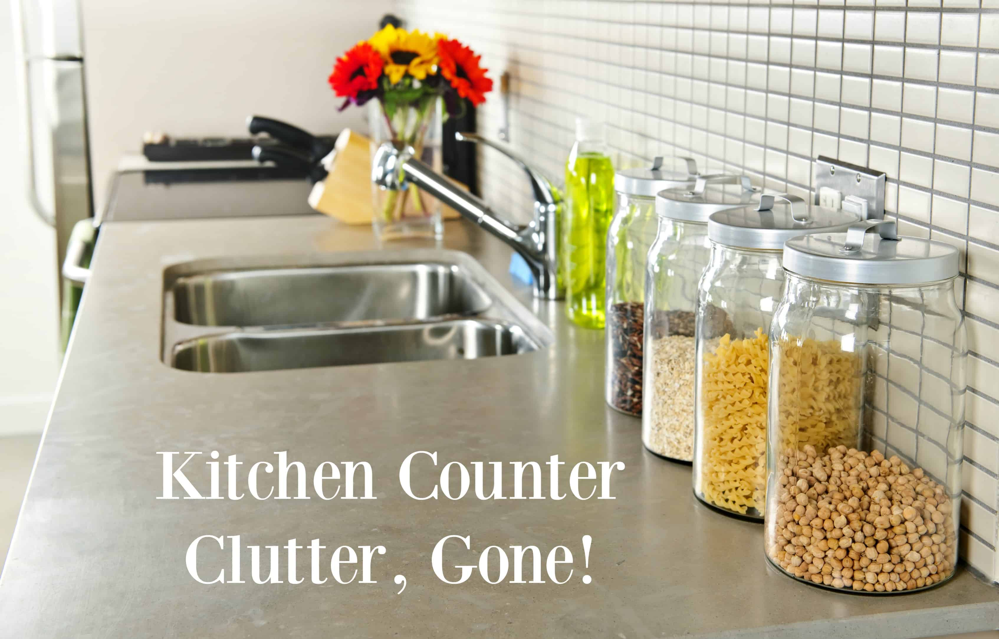 keeping kitchen counters clear the organized mom modern small kitchen interior with glass jars on natural stone countertop