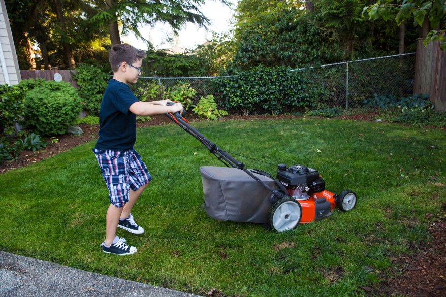 child mowing lawn