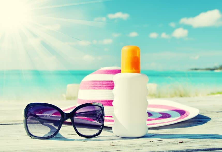 sunhat sunglasses sunscreen on the beach