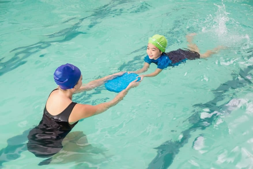 swim instructor teaching