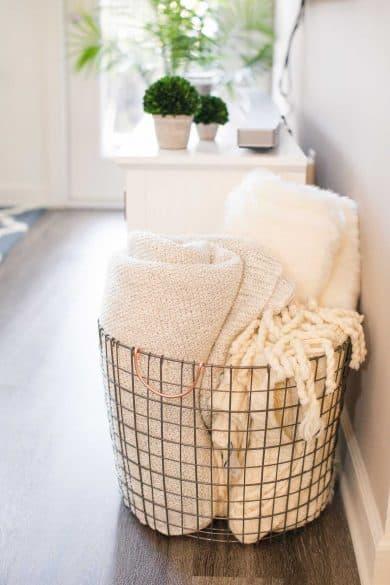 blankets in a wire basket