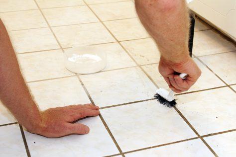 srcubbing floor with baking soda