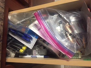 Collection of junk in drawer.