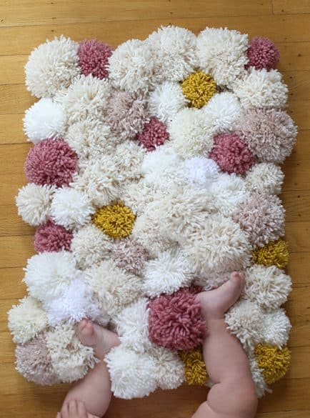 pom pom rug--nursery room decor