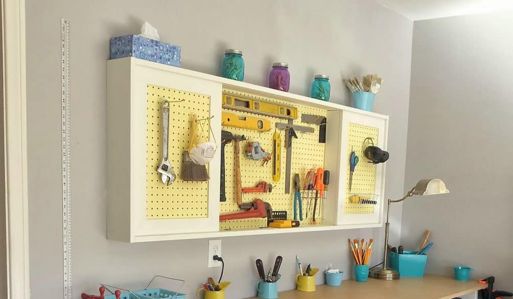 DIY-tutorial-to-build-a-workbench-and-pegboard-tool-cabinet-with-sliding-doors-featured-on-Remodelaholic