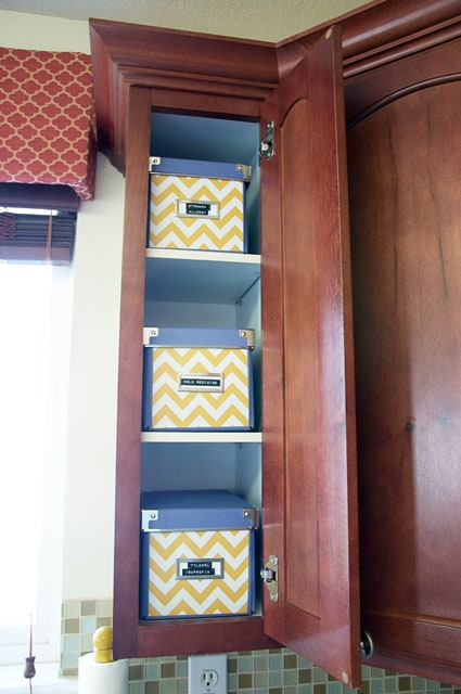 open cabinet with boxes inside
