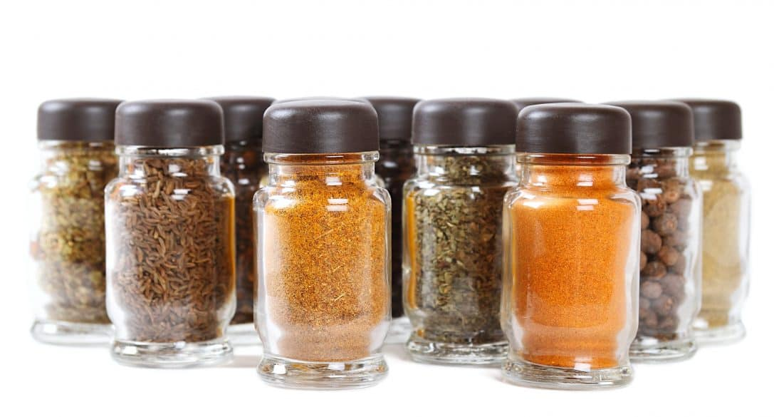 spices in glass bottles