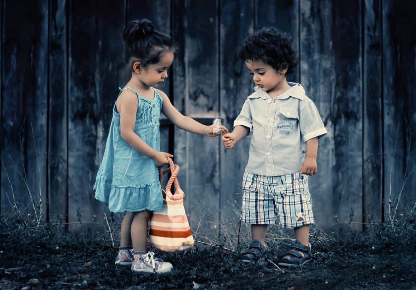 children picking dandelions