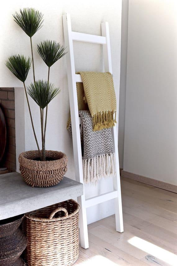hanging blankets on ladder