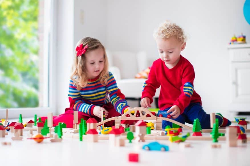 children playing with toy train