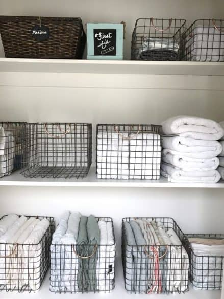 linens organized in wire baskets