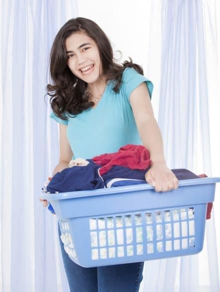 teen girl doing laundry