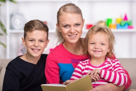 Young mother and her two children are reading a book together find satisfaction in being organized