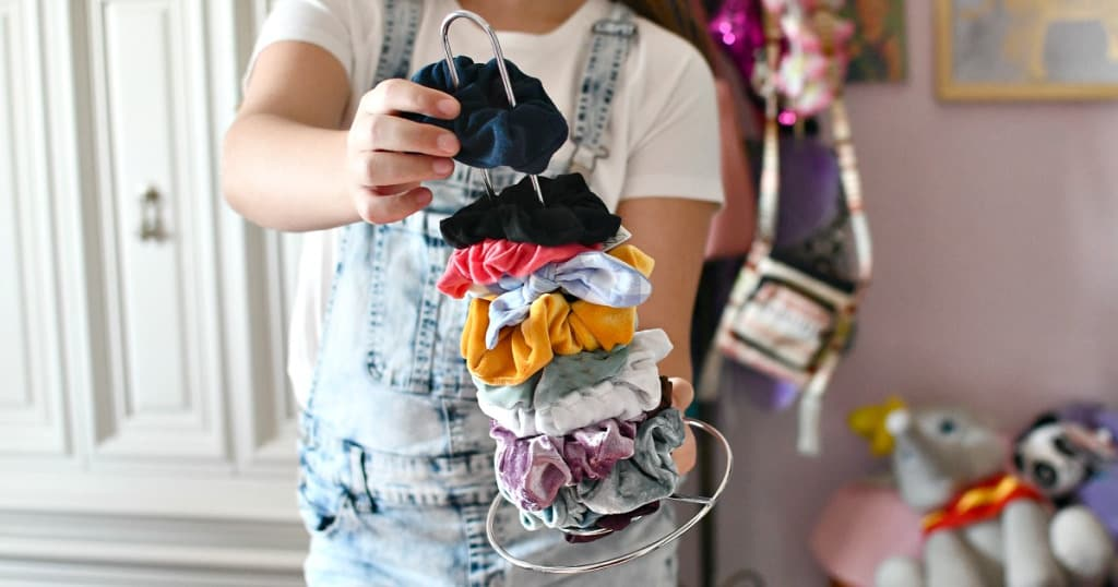 organize your scrunchies on a paper towel holder