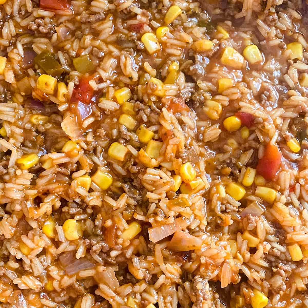 ground beef sauce rice and vegetables cooking