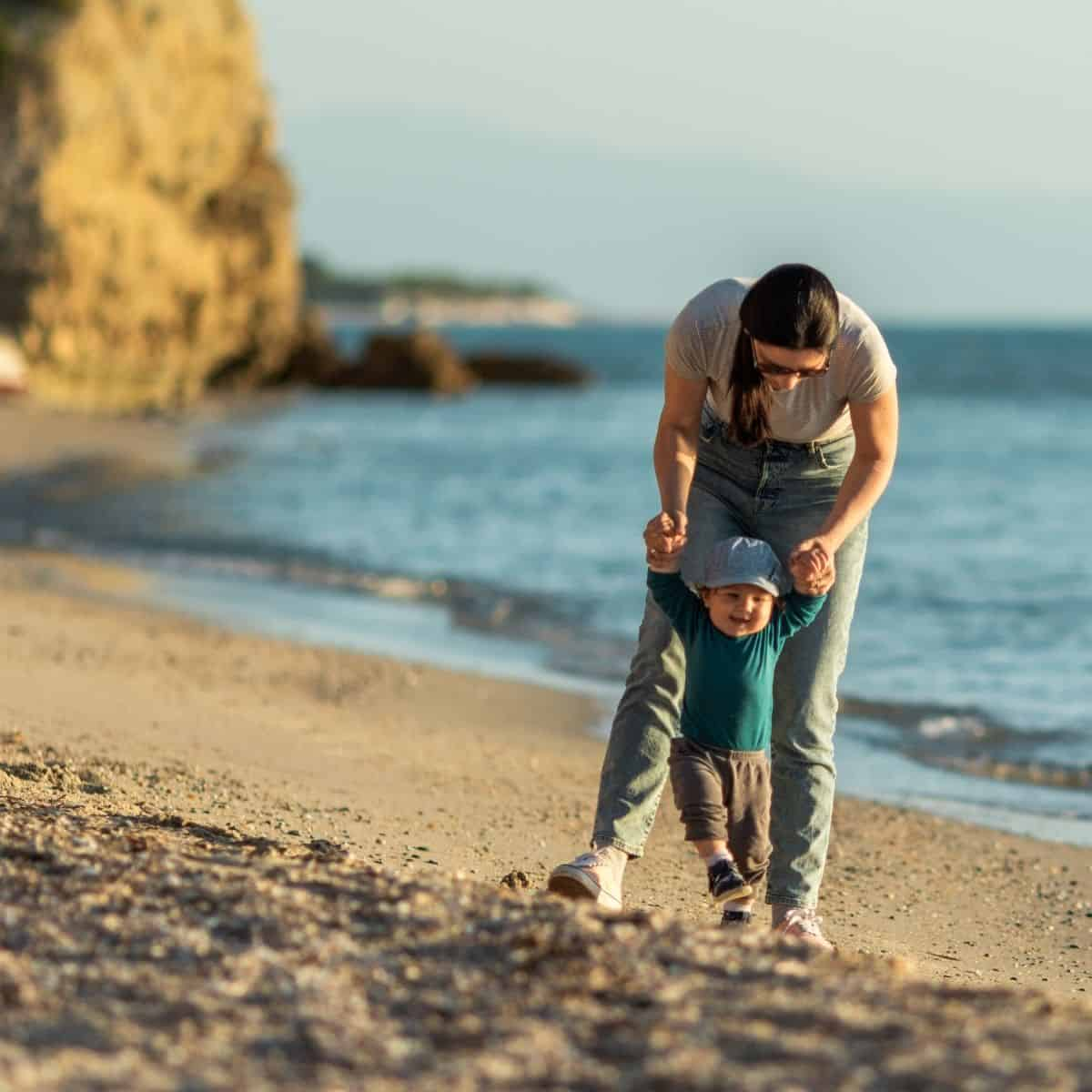 mother and child on beach mothers day