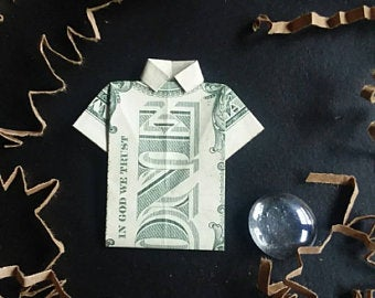 An origami shirt made out of a dollar bill.