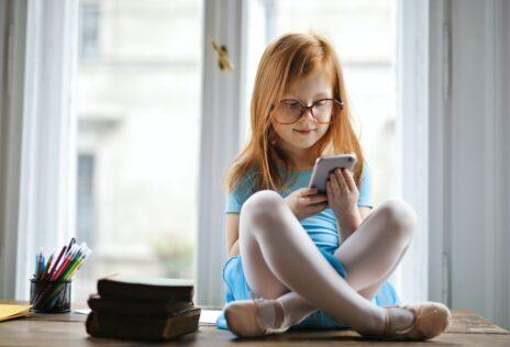 girl-reading Ways to Organize Children's Books