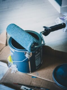 paint and roller painting kitchen cabinets